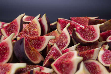 Tasty figs background. Top view. Slices.