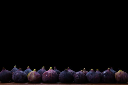Tasty figs on a black background. Top view. Slices. Banco de Imagens