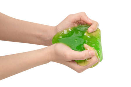 Green slime toy in woman hand isolated on white background.