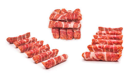 Chevapchichi in bacon isolated on white background.