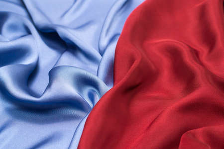 Red and blue silk or satin luxury fabric texture. Top view. Standard-Bild