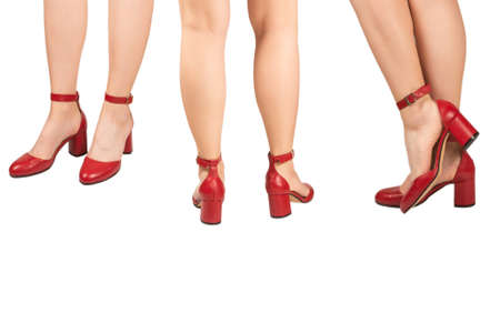 Woman legs in retro red sandals on heels isolated on white background. Standard-Bild