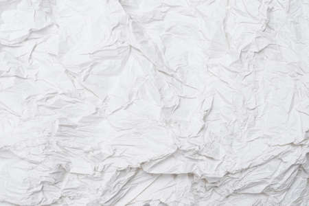 Crumpled white paper background. Top view.