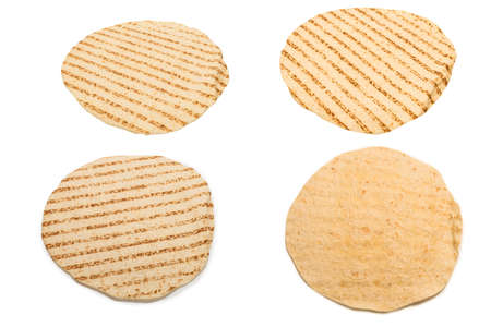 Grilled pitta bread isolated on white background. Top view. Фото со стока