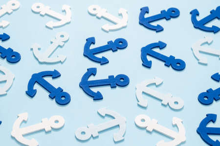 Blue anchors on a blue background. Pattern.