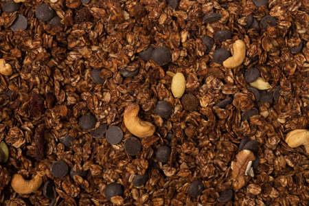 Chocolate granola cereal with nuts background. Top view.