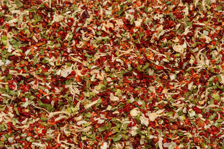 Seasoning for soup, dried vegetables slices background. Top view. Standard-Bild