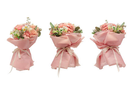 Bouquet of soft pink flowers in pink wrapping paper. Standard-Bild