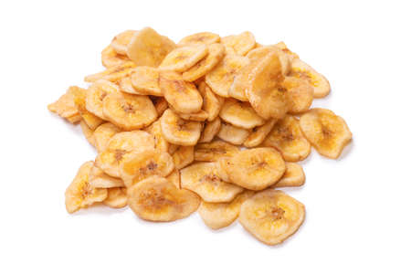 Banana chips isolated on a white background. Dehydrated banana slices.