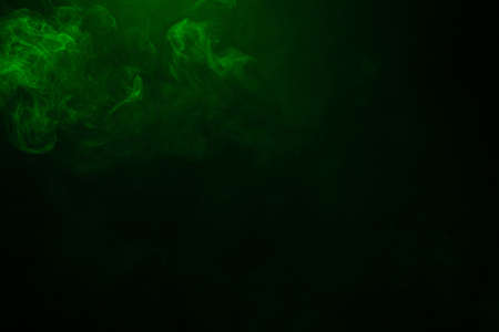Green and pink steam on a black background. Copy space. Standard-Bild