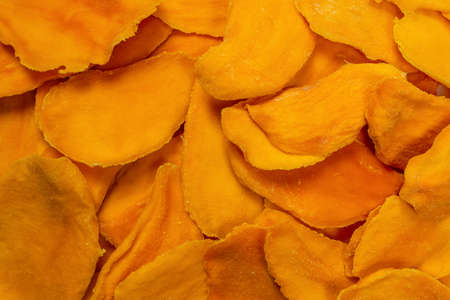 Dry tasty mango slices isolated on a white background. Top view. Standard-Bild