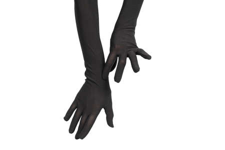 Woman puts on long black gloves isolated on a white background. Standard-Bild