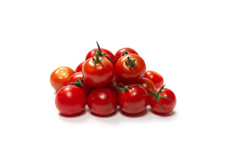 Many little cherry tomatoes isolated on white background. Group of cherry tomatoes. Standard-Bild