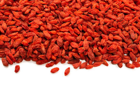 Group of red berries goji isolated on a white background. Standard-Bild