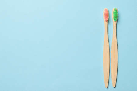 Bamboo toothbrush on a blue background. Top view. Standard-Bild