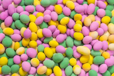 Group of colorful peanuts in glaze. Top view. Standard-Bild