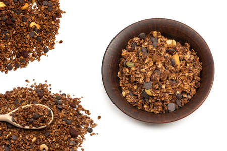 Chocolate granola cereal with nuts. Isolated on white bacckground. Imagens