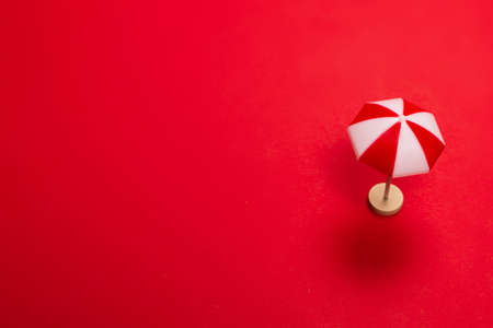 Red umbrella on a red background. Copy space. Imagens