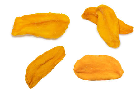 Dry tasty mango slices isolated on a white background. Top view. Imagens