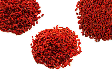 Group of red berries goji isolated on a white background. Imagens