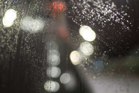 Blurred background with raindrops and lights. Imagens