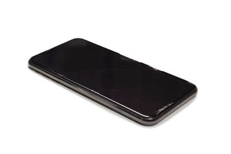 Smart phone with broken screen. isolated on a white background. Top view. Imagens