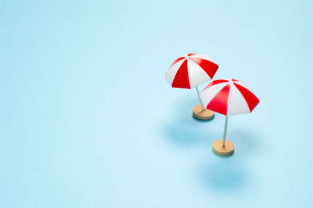 Red umbrella on a blue background. Copy space.