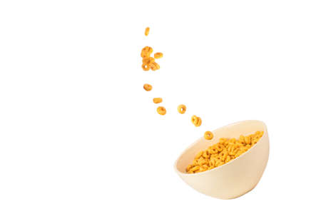 Honey rings cereal box for morning breakfast. Corn flakes falling to the white bowl. Motion. Copyspace. Imagens