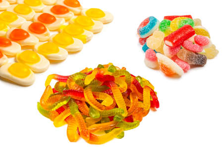 Assorted gummy candies. Top view. Jelly sweets. Isolated on white. Imagens