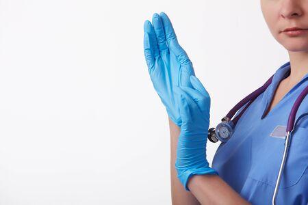 doctor wears gloves photo