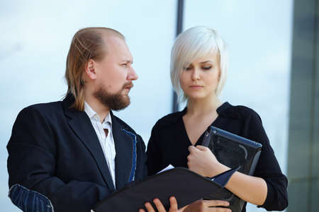 discussing: businessman and business woman are discussing