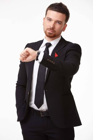 Businessman in a suit looking at his watch photo