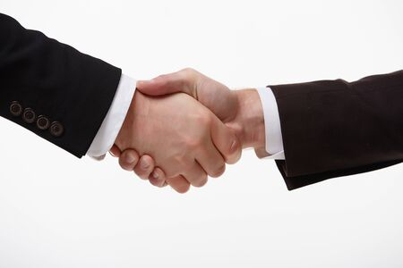 shaking hands: handshake of two businessmen fore