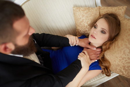 strangling: man strangling a woman on the bed