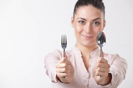 woman with spoon and fork Stock Photo - 37959181