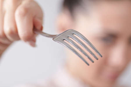 woman with spoon and fork photo