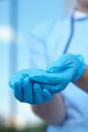 medical gloves: woman doctor in medical gloves Stock Photo