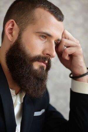 long beard: man in a suit with a long beard