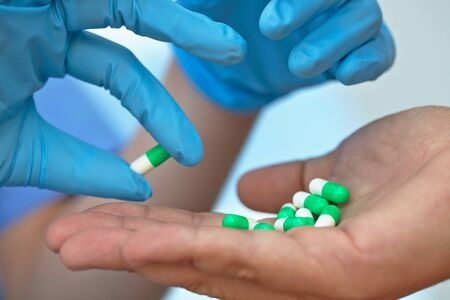 gave: the doctor gave the patient medication capsules
