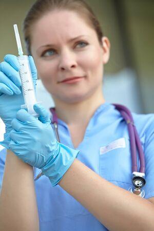 female doctor holding a syringe photo