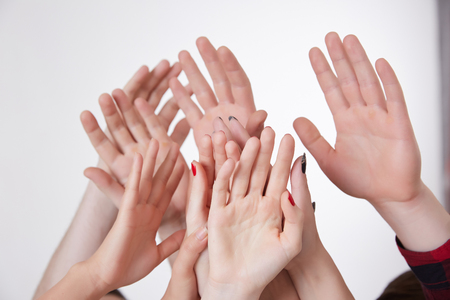 reaching up: many hands reaching up