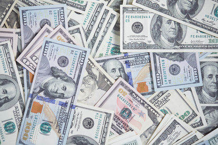 manner: money in a chaotic manner on the floor