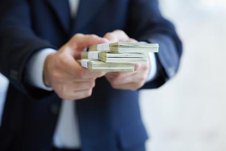 closeup money in male hands Banco de Imagens