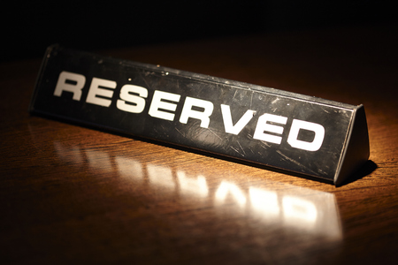 Reserved plate on a table in a restaurant Stock Photo
