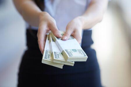 women's hands: Money close-up in womens hands