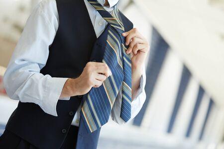his: Businessman tying his tie Stock Photo