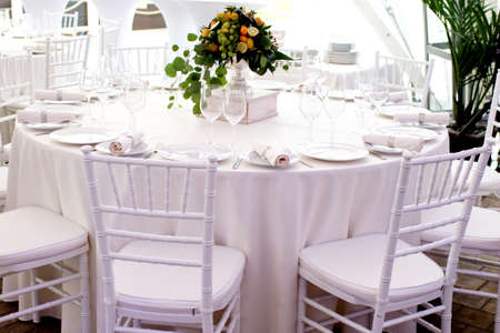restaurant tables: white chairs, white tablecloths on the tables in the restaurant