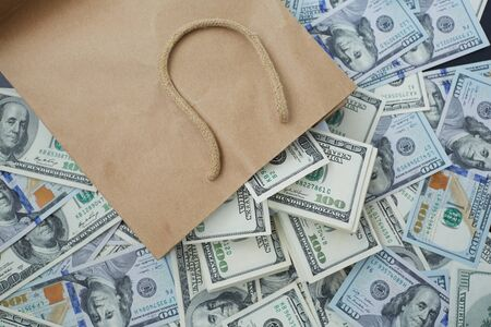 profusion: much money out of a paper bag Stock Photo