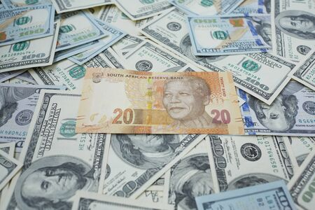 rand: twenty rand against the background of dollars