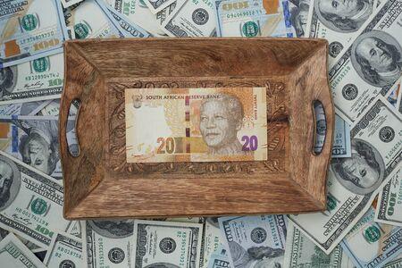 rand: a tray of twenty rand and dollars Stock Photo